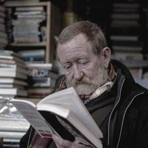 Man reading a personal memoir written by Elephant Memoir's Joss Carpreau